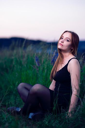 Next shot from my last shooting. Grass Sitting Field Young Women Black Clothes Brown Hair Blue-green Eyes Outdoors Sky Portrait Body Shot Grass Purple Purple Flower Girl Head In The Kneck Jena Winzerla