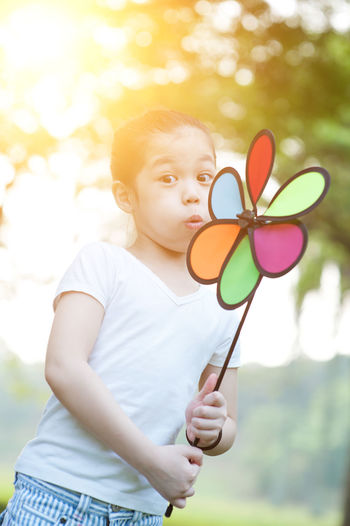 Casual Clothing Child Childhood Cute Day Focus On Foreground Front View Holding Innocence Leisure Activity Lifestyles Nature One Person Outdoors Pinwheel Toy Real People Toy Waist Up