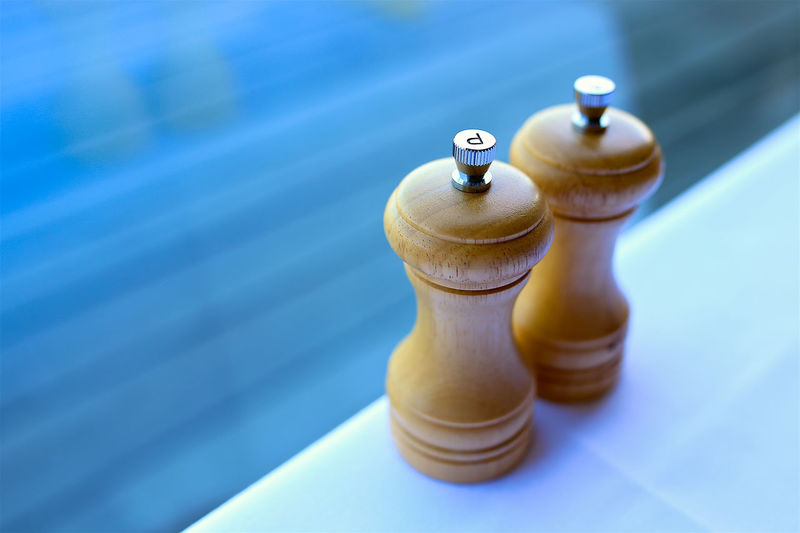 High angle view of salt and pepper shaker on table