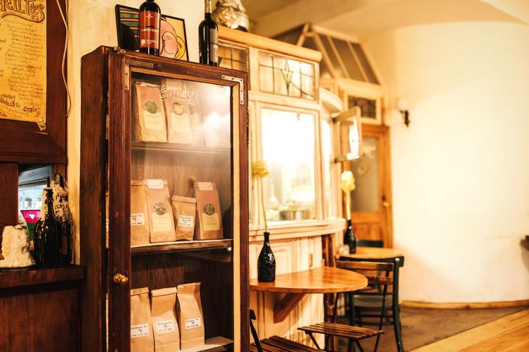 Coffee to go? Display Cabinet Display Light Reflection Cozy Place Laden Shop Coffee Break Coffee Cabinet Shop Interior Berlin Cafe Time Cafe Warm Light Warm Colors Interior Design Indoors  Old-fashioned No People Wood - Material Table Chair Antique