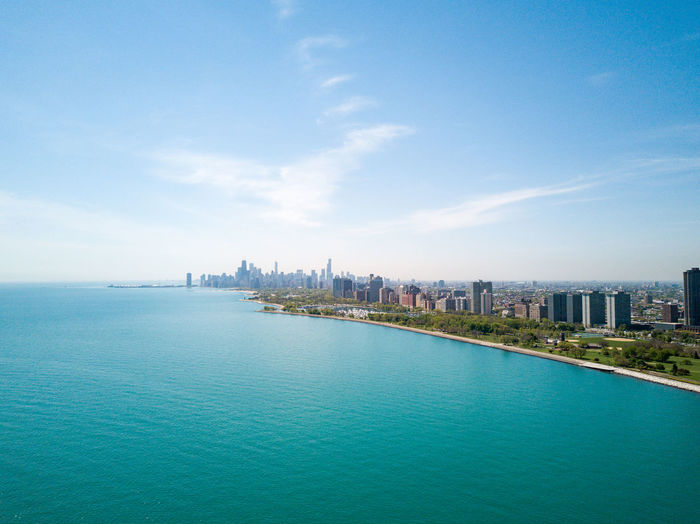 Aerial view of Chicago Architecture Beauty In Nature Blue Building Exterior Built Structure City Cityscape Day Drone  Modern Nature No People Outdoors Scenics Sea Sky Skyscraper Tourism Tower Travel Travel Destinations Urban Skyline Water Waterfront