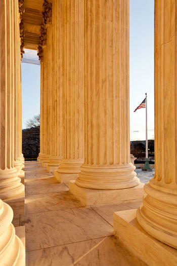 United States Supreme Court building in Washington DC in the USA American Court Entrance Government Supreme Court Building Supreme Court USA USA FLAG United States Washington Washington DC Washington, D. C. America Columns Constitution Courthouse Flag Justice Law Supreme
