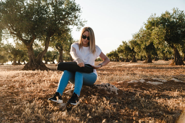 Woman sitting at olive orchard