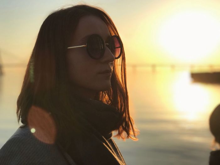 Real People Headshot Water One Person Lifestyles Portrait Focus On Foreground Leisure Activity Women Adult Sunset Sky Nature Young Adult Sea Outdoors Young Women Hairstyle Sunlight Teenager