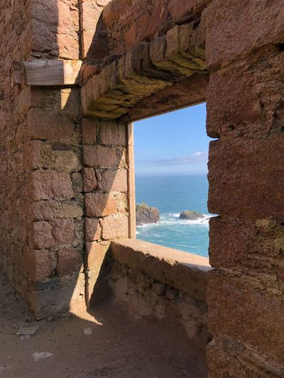 View to sea Ruin Old Blue Sky Abandoned EyeEm Selects Architecture Built Structure Nature Sunlight Stone Wall Window Horizon Shadow Wall - Building Feature