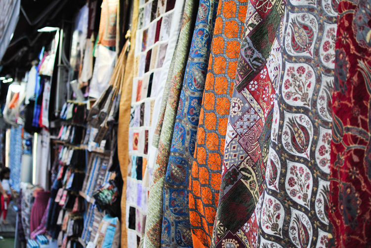 Close-up of textile hanging in market for sale
