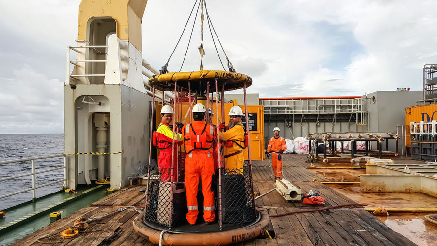 Offshore crews using Billy Pugh personnel transfer basket Construction Industry Offshore RISK Transport Transportation Workers Basket Billy Pugh Crew Crewlife Editorial  Malaysia Marine Movement Oil And Gas, People Personnel Transfer Rope Swing Safety Safety Equipment Sea And Sky Transfer Transportation People Vessel