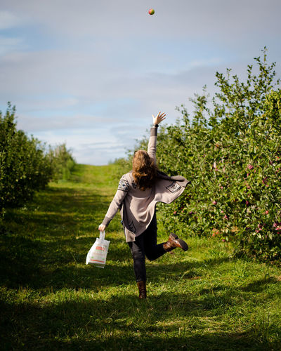 Full Length Of Young Woman At Apple Orchard