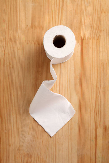 toilet roll on the wooden background High Angle View Toilet Paper Indoors  Wood - Material Hygiene Flooring No People Close-up Wood Wood Grain Paper Rough Rough Texture Smooth Rolled Up Bathroom White Color Flooring Still Life Directly Above Facial Hair Tissue Paper Studio Shot Copy Space Clean