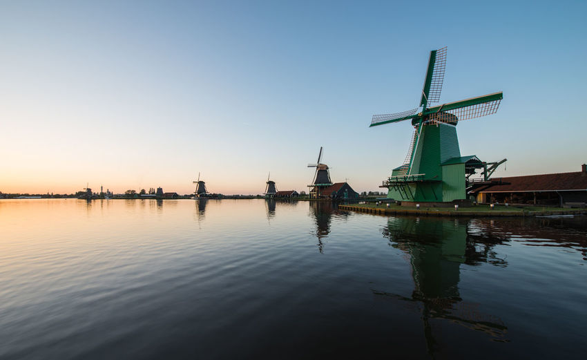 Zaanse schans, holland - Windmills in sunset Alternative Energy Blue Clear Sky Environmental Conservation Fuel And Power Generation Industrial Windmill Lake No People Outdoors Reflection Renewable Energy Riverbank Rural Scene Scenics Sea Traditional Windmill Water Waterfront Wind Power Wind Turbine Windmill