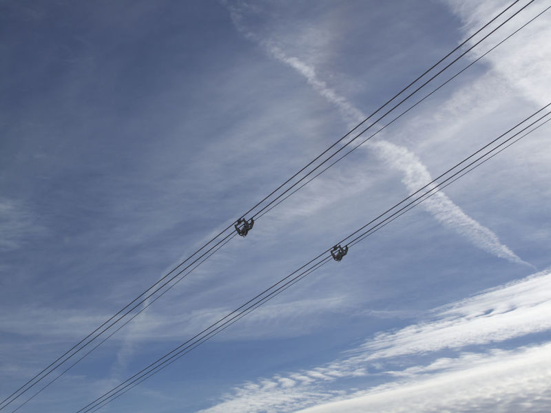 Cable Cloud - Sky Connection Day Electricity  Electricity Pylon Fuel And Power Generation Low Angle View Nature No People Outdoors Power Line  Power Supply Sky Vapor Trail