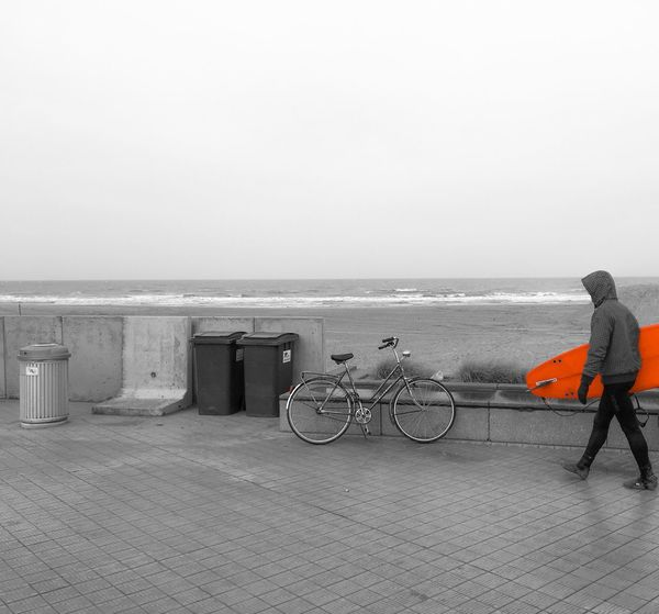 Adapted To The City Surfer Winter Ostend Belgium Sea Horizon Over Water Beach Clear Sky Bicycle Real People Outdoors Water Day Nature Sky Scenics One Person