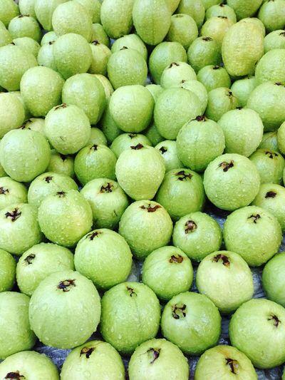 Full frame shot of wet guavas for sale at market