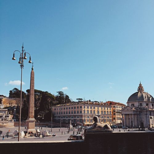 Piazza del popolo against blue sky on sunny day