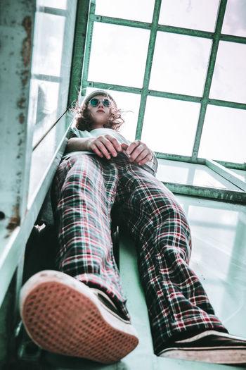 Low Angle View Of Teenage Girl Wearing Sunglasses