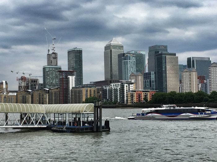 Zoom .... The Thames Clipper disappearing out of frame. Canary Wharf captured with dramatic Sky And Clouds Urban Skyline LONDON❤ EyeEm Selects EyeEm LOST IN London