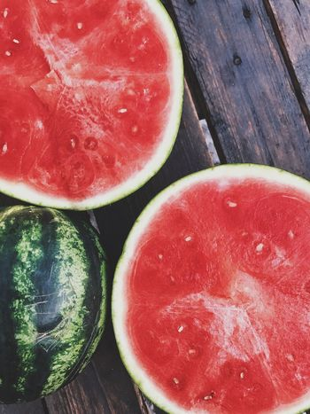 A sweet taste of summer. half in half A Taste of Life Fresh Freshness Half In Half Summer Healthy Summer Fruit Red Watermelon Healthy Eating Food And Drink Freshness Food Wellbeing Still Life Fruit Close-up SLICE High Angle View Table Wood - Material Cross Section Juicy