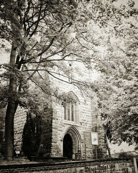 Some churches are really pretty. I have relatives buried here; my great grandparents recently had flowers put on their grave seventy years after their death. Church Spooky Atmospheric Trees Old England Architecture Staffordshire England Old Mobilephotography