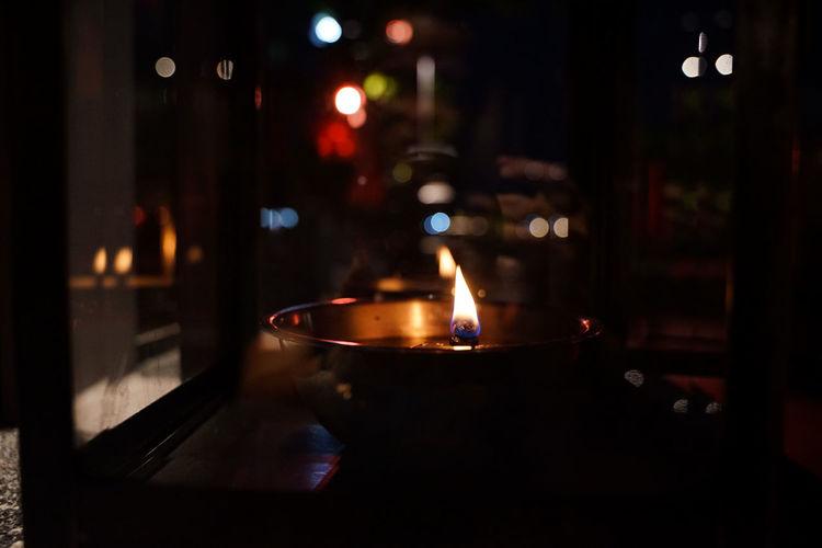 Lit tea light candles in dark room