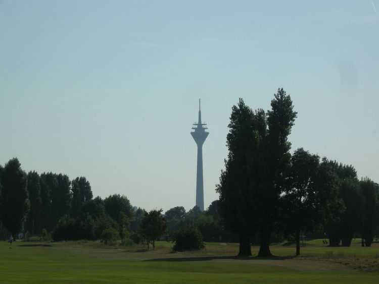 Clear Sky Communications Tower Day Famous Place Field Grass Growth Landscape Lawn Nature Non-urban Scene Outdoors Park - Man Made Space Scenics Sky Solitude Spire  Tall Tall - High Tourism Tower Tranquil Scene Tranquility Travel Destinations Tree