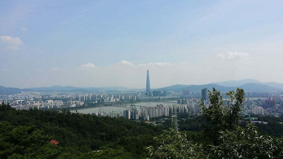 Distant View Of Lotte World Tower In City Against Sky On Sunny Day