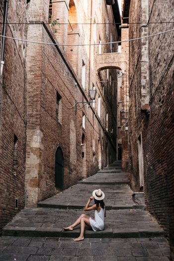 Architecture Italy Italian Street Girl Traveler Girl In Hat Girl In Hat Looking At Historical Buildings Old Town Streets Old Buildings Siena Wanderlust Wandering Travel Photography