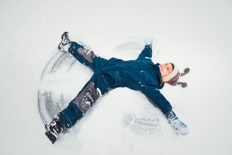 Full length of boy playing with snow