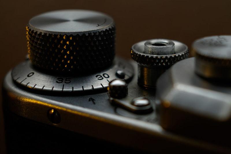 Close-up of knob on camera