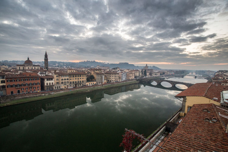 Architecture Arno  Bridge - Man Made Structure Building Exterior Built Structure City City Life Cityscape Cloud - Sky Connection Day Downtown District Florence Florence Italy Illuminated Italy❤️ No People Outdoors Reflection River Sky Transportation Travel Destinations Urban Skyline Water