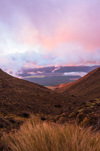 Sunset in Tongariro National Park Tongariro Crossing Travel Beauty In Nature Colorful Day Dusk Idyllic Landscape Mountain Mountain Range Nature New Zealand No People Outdoors Plant Remote Scenics - Nature Sky Sunset Tranquility
