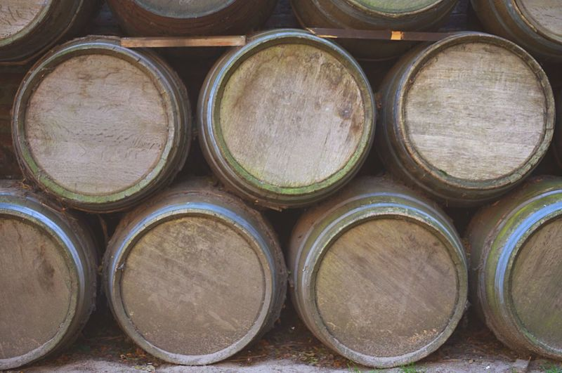 Stacked old casks Heap Stack Pile Weathered Old Cask Stack Abundance Barrel Cellar Arrangement Large Group Of Objects No People Wine Cellar Wine Cask Winery