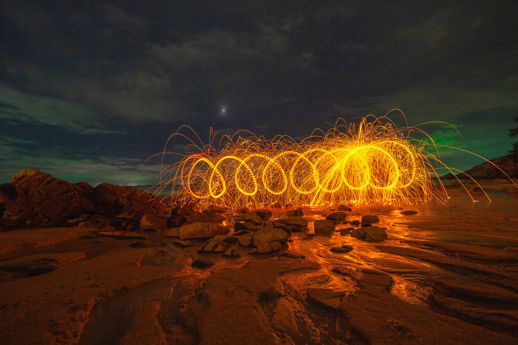 cool burning steel wool art fire work photo experiments on the beach at sunset Art Firworks, Firework, Sunset, Beach, Nature, Red, Spinning Light, Twight, Sky, Fire, Reflect, Sea, Star, Jewish, David, Symbol, White, Israel, Holiday, Background, Hebrew, Blue, Religion, Judaism, Decoration, Old, Art, Religious, Jew, Gold, Israeli, Ornament, Sign, Judaic, Isolated, Cemetery, Hexagram, Memorial, Star Of David, Vintage, Texture, Ancient Heart, Hot, Hot, Hot Steel Wool, Night Illuminated Long Exposure Motion Glowing Sky Land Nature Blurred Motion No People Cloud - Sky Wire Wool Orange Color Outdoors Light Painting Sand Beach Water Rock - Object Rock Formation