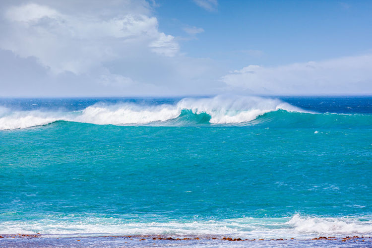Scenic view of sea wave against sky