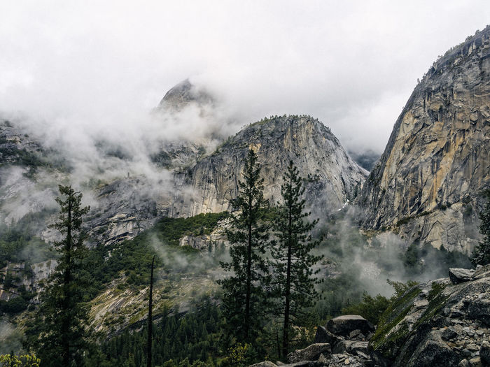 Beauty In Nature Cloud - Sky Cloudy Day Fog Geology Idyllic Landscape Majestic Mountain Mountain Range Nature Non-urban Scene Outdoors Physical Geography Remote Rock - Object Rocky Mountains Scenics Sky Tranquil Scene Tranquility Tree Weather Yosemite National Park