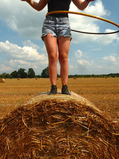 Summer fun Agriculture Carefree Casual Clothing Cloud - Sky Cloudy Cultivated Land Dancing Girl Day Farm Field Getting Away From It All Growth Hooping  Jeans Shorts Leisure Activity Lifestyles Low Section Nature Outdoors Person Rural Scene Sky Straw Bales Summer Vibes Tranquility