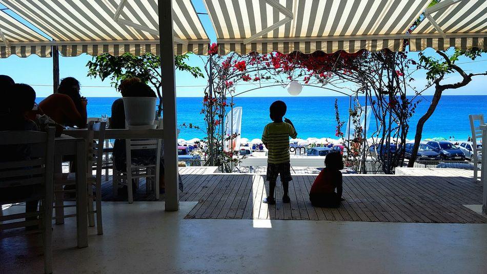 Tropical Climate Sunny Relaxation Travel Destinations Enjoyment Travel Lefkada Greece Kathisma Kathisma Beach Vacations Silhouettes Water Sea Summer Veranda Verandah Outdoors Restaurant Bar People Children Perspectives On People