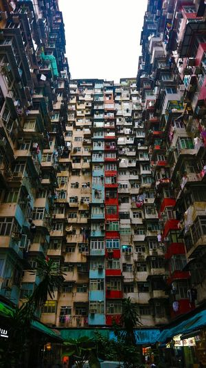 Architectural Monster. Travel Travelphotography Architecturalphotography HongKong Quarrybay Colorfulbuilding Colorful Residential  #Windows #cityscapes City Cityscape Clear Sky Sky Architecture Building Exterior Built Structure High Rise Residential District