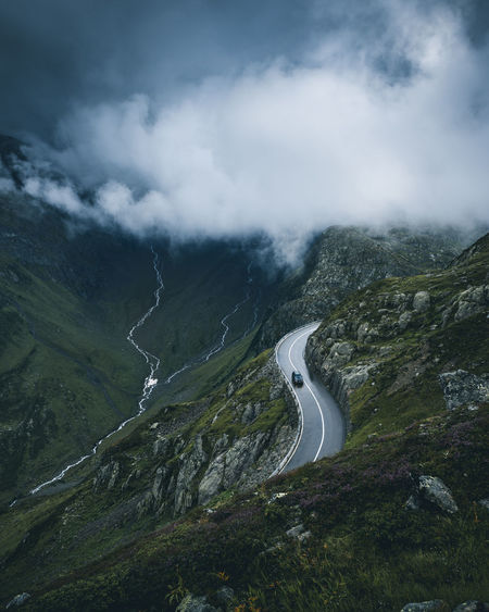 Driving through the Rain Dramatic Sky Green Pass Rain Sustenpass Weather Alps Beauty In Nature Car Clouds Day Mood Mountain Mountains Nature No People Outdoors Road Roadtrip Scenics Sky Switzerland Tranquil Scene Tranquility Winding Road Fresh On Market 2017