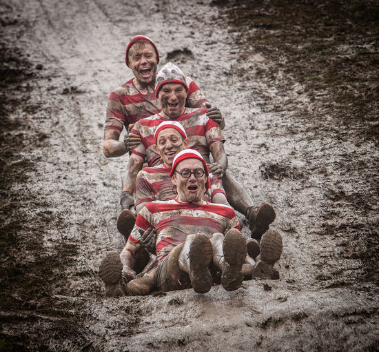 4 guys having fun down a mud slide during a Tough Mudder event Art Casual Clothing Day Leisure Activity Lifestyles Nature Outdoors Portrait First Eyeem Photo