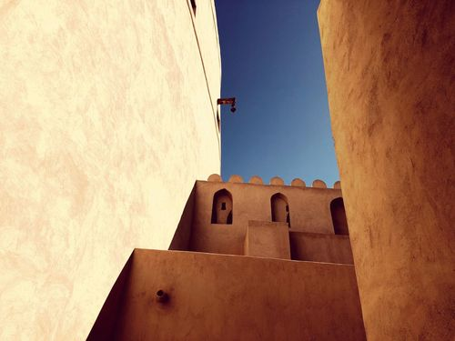 Ancient Nizwa History Walls Former Capital Of Oman Protection Old Building  Nizwa History Nizwa Fort EyeEm Selects Built Structure Architecture Low Angle View No People Building Exterior Sunlight Day Outdoors Sky