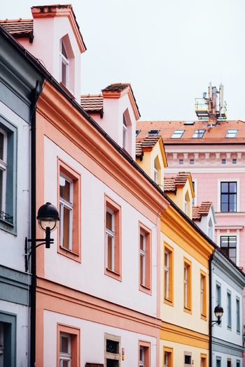 colorful buildings Ceske Budejovice Old Buildings Building Exterior Architecture Built Structure Building Window Low Angle View No People Residential District Nature Day City Clear Sky Outdoors House Roof Street Light The Architect - 2018 EyeEm Awards