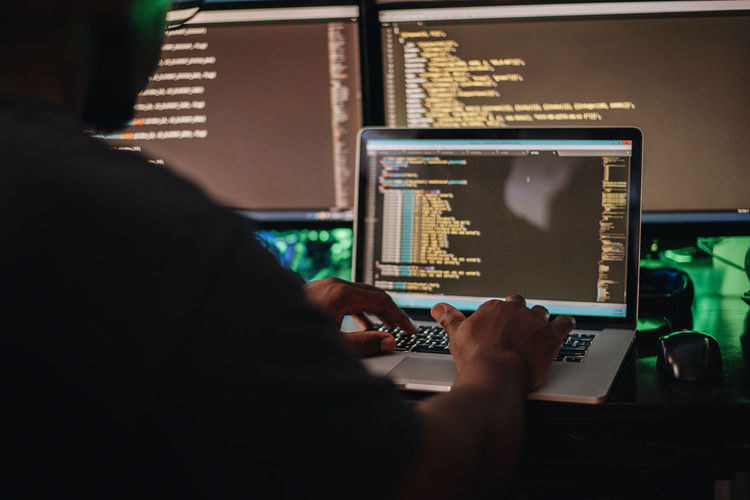 African american or black man at computer desk programming apps or web developing