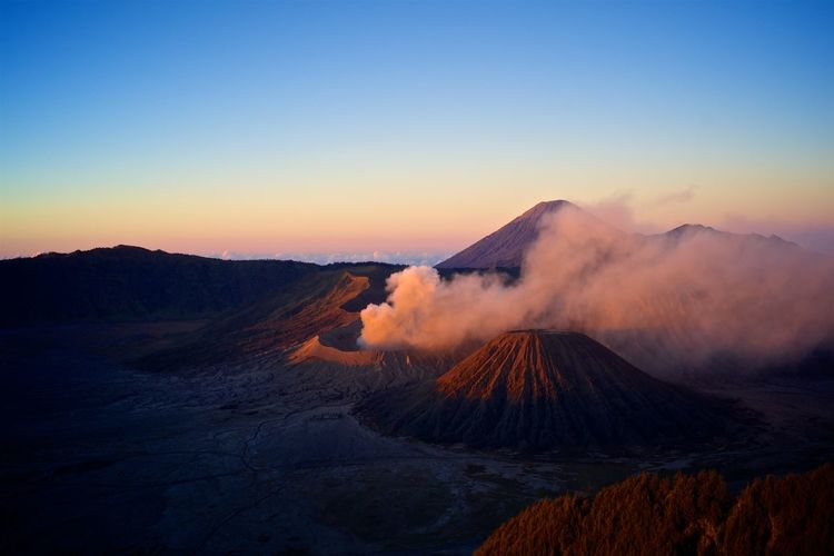 Smoke Emerging From Volcanic Landscape