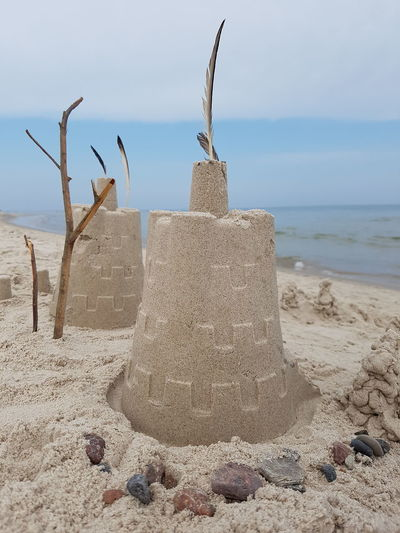 Close-up of sandcastles at beach