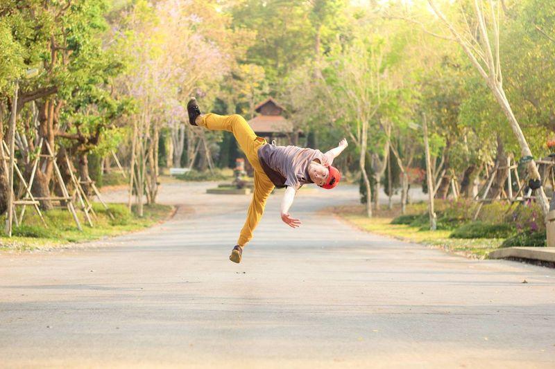 Full Length Of Man Performing Stunt On Road