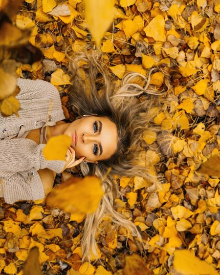 Feelin Fall. Autumn Leaf Yellow Change Looking At Camera Leaves Long Hair Young Women Nature Beautiful Woman Portrait Young Adult Smiling One Person Beauty Beauty In Nature Lifestyles Lying Down Leisure Activity Maple Leaf
