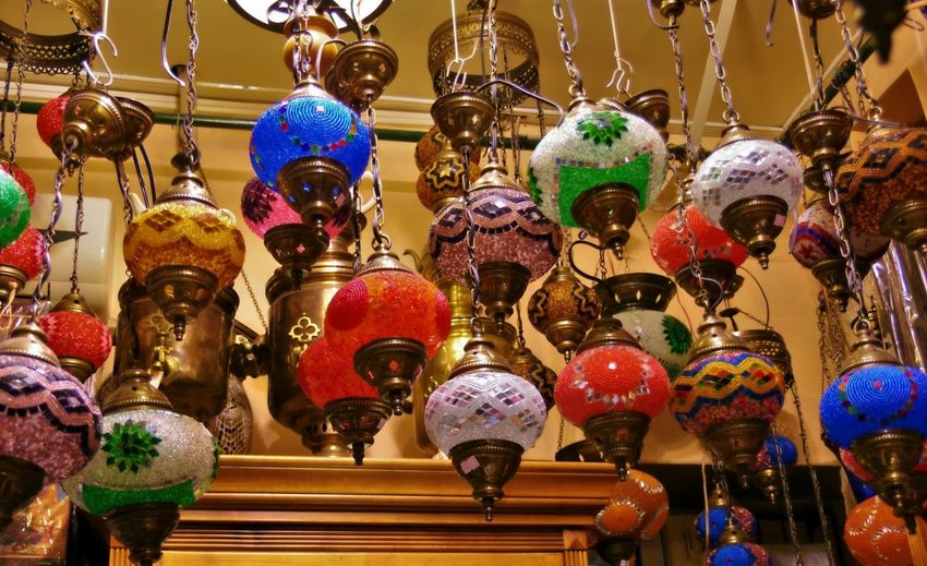 Low angle view of lanterns hanging for sale in store