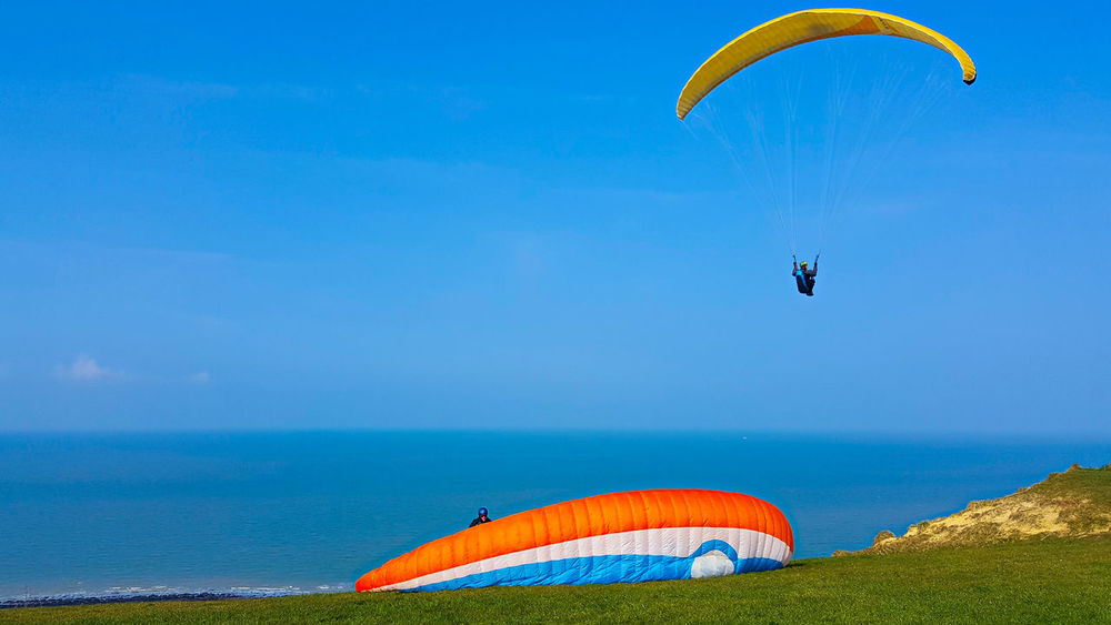 Adventure Beach Beauty In Nature Blue Day Extreme Sports Flying Horizon Over Water Leisure Activity Mid-air Nature Normandy Beach Outdoors Parachute Paragliding Parasailing Scenics Sea Shore Sky Summer Tranquil Scene Tranquility Water Water Sport
