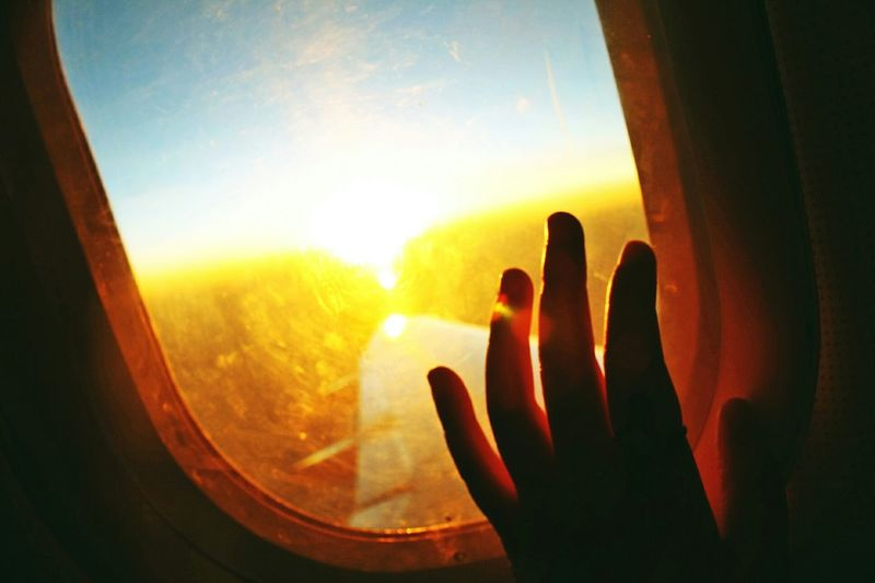 """Wade through the fire and jump the fances, the light we create is so much bigger than the darkness we've come through."" The Traveler - 2015 EyeEm Awards Sunset Silhouettes Silhouettes Light And Shadow Sunset_collection From An Airplane Window Airplane Travel Traveling Holiday POV"