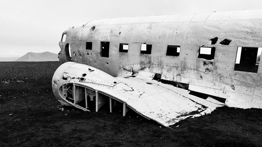 Abandoned Airplane On Runway Against Sky